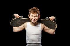 Skateboarder με τον πίνακα Στοκ φωτογραφία με δικαίωμα ελεύθερης χρήσης
