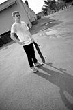 Skateboarder. A young skater teen posing in an urban area with his board Royalty Free Stock Photos