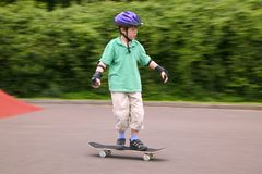 Skateboarder. Young boy in action on his skateboard stock photography