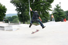 Skateboarder 360 Flip. Teen male skateboarder doing a 360 flip at a skatepark. Shot with Canon 20D Stock Photography