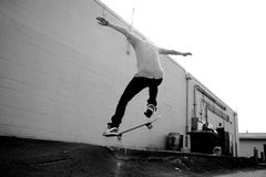 Skateboarder. A young skateboarder doing a stunt in an urban area Royalty Free Stock Images