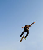 Skateboarder. Young teen boy skateboarder doing a high jump Royalty Free Stock Photos