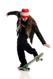 Skateboarder in Action. Young skateboarder in action isolated over white background Royalty Free Stock Photography