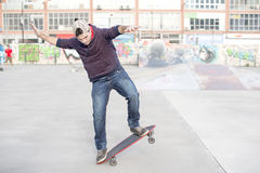 Skateboarder in action in the skate park. Stock Photo