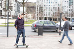 Skateboarder in action on the street. Stock Photography