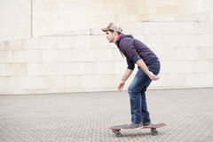 Skateboarder in action in the street. Royalty Free Stock Image