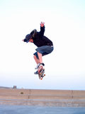 Skateboarder in the air doing a stunt Royalty Free Stock Images