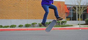 Skateboarder air trick Stock Image