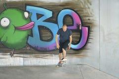 Skateboarder begins his run Stock Images