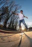 Skateboarder on a board slide royalty free stock image
