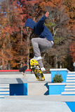 Skateboarder Catches Air At Skateboard Park Stock Photo