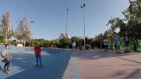 Skateboarder Changing Skateboard in the Air Slow Motion. Kids Riding a Skateboard And Jumping Air Trick in Skatepark Bowl of Turia River Park, Valencia, Spain stock footage
