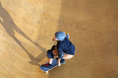Skateboarder coming. Skateboarder riding into the bowl stock photos