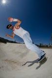 Skateboarder in a concrete pool Stock Photos
