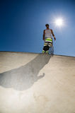 Skateboarder in a concrete pool Royalty Free Stock Photo