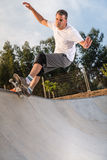 Skateboarder in a concrete pool Royalty Free Stock Image