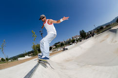 Skateboarder in a concrete pool Stock Images