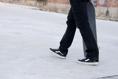 Skateboarder on a concrete slab Stock Image
