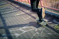 Skateboarder cruise on bridge Royalty Free Stock Images