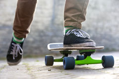 Skateboarder departing Stock Image