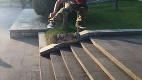 Skateboarder does trick from the steps stock footage