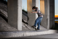 Skateboarder doing 5-0 grind on ledge Royalty Free Stock Photo