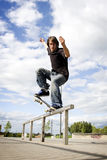 Skateboarder doing a crooked grind Stock Photography
