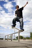 Skateboarder doing a crooked grind Royalty Free Stock Photography