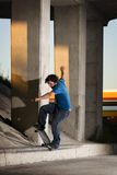 Skateboarder doing a grind on curb Royalty Free Stock Photos