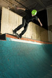 Skateboarder doing a grind on ramp Royalty Free Stock Photo