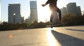 Skateboarder doing an ollie trick Stock Photography