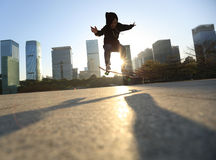 Skateboarder doing an ollie trick Stock Images