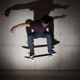 Skateboarder doing a skateboard trick Stock Photos