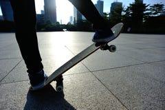 Skateboarder doing skateboarding trick ollie on city Stock Images