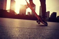 Skateboarder doing skateboarding trick ollie on city Royalty Free Stock Images
