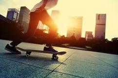 Skateboarder doing skateboarding trick ollie Royalty Free Stock Photography