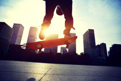Skateboarder doing skateboarding trick ollie Stock Image