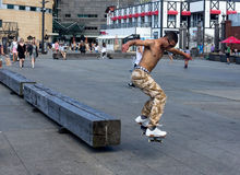 Skateboarder doing skating tricks. Wellington, New Zealand - February 10, 2017: Young skateboarder is doing skating tricks at the Wellington waterfront Royalty Free Stock Image