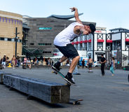 Skateboarder doing skating tricks. Wellington, New Zealand - February 10, 2017: Young skateboarder is doing skating tricks at the Wellington waterfront Stock Photos