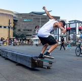 Skateboarder doing skating tricks. Wellington, New Zealand - February 10, 2017: Young skateboarder is doing skating tricks at the Wellington waterfront Royalty Free Stock Photos