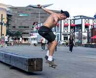 Skateboarder doing skating tricks. Wellington, New Zealand - February 10, 2017: Young skateboarder is doing skating tricks at the Wellington waterfront Stock Photo