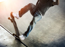 Skateboarder doing a trick Stock Photos