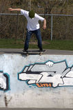 Skateboarder doing trick on ramp. Boucherville Skatepark, Quebec, Canada Royalty Free Stock Photos