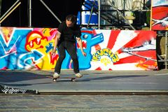 Skateboarder doing a trick in a skate park stock images