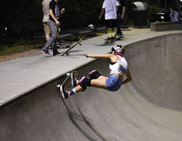 Skateboarder doing trick at skatepark Stock Images