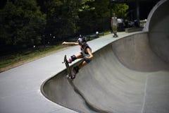 Skateboarder doing trick at skatepark. Female skateboarder doing trick at skatepark in Houston stock photography