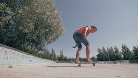 Skateboarder doing tricks in a city. Slow motion, 100 fps. stock video