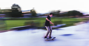 Skateboarder doing tricks during evening session Royalty Free Stock Image