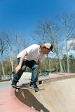 Skateboarder Falling Into the Bowl Royalty Free Stock Image