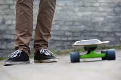 Skateboarder feet and skateboard in urban setting Stock Photography